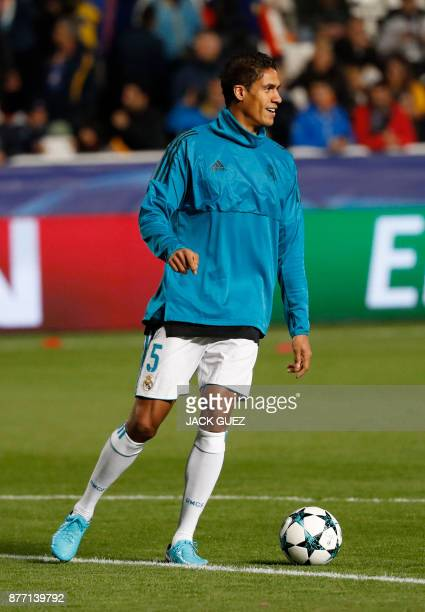 Real Madrid's French defender Raphael Varane warmsup ahead of the UEFA Champions League Group H match between Apoel FC and Real Madrid on November 21...