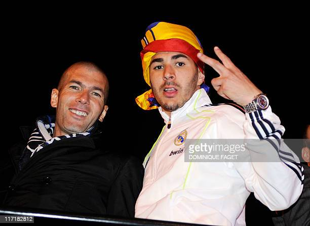Real Madrid's French forward Karim Benzema and Zinedine Zidane celebrate in Madrid on April 20 after Real Madrid won the Spanish Cup final match...