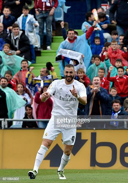 Real Madrid's French forward Karim Benzema celebrates a goal during the Spanish league football match Getafe CF vs Real Madrid CF at the Coliseum...