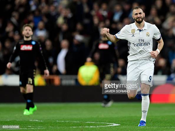 Real Madrid's French forward Karim Benzema celebrates a goal during the UEFA Champions League round of 16 first leg football match Real Madrid CF vs...
