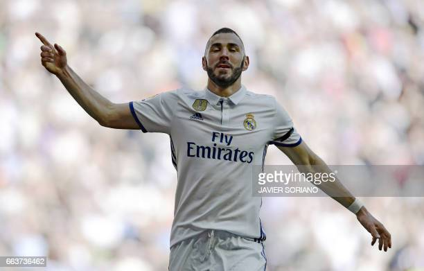 Real Madrid's French forward Karim Benzema celebrates a goal during the Spanish league football match Real Madrid CF vs Deportivo Alaves at the...