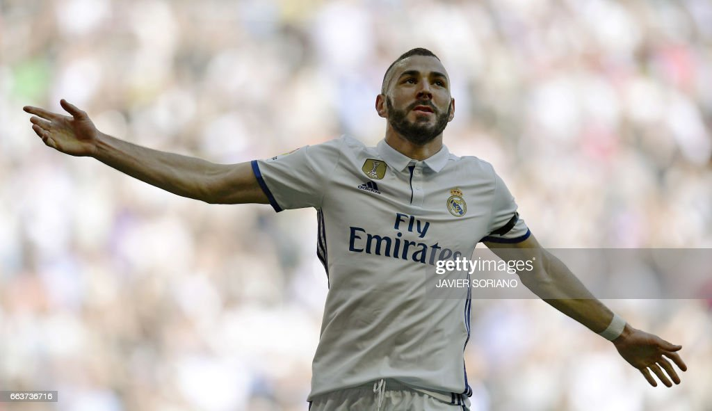 TOPSHOT - Real Madrid's French forward Karim Benzema celebrates a goal during the Spanish league football match Real Madrid CF vs Deportivo Alaves at the Santiago Bernabeu stadium in Madrid on April 2, 2017. /