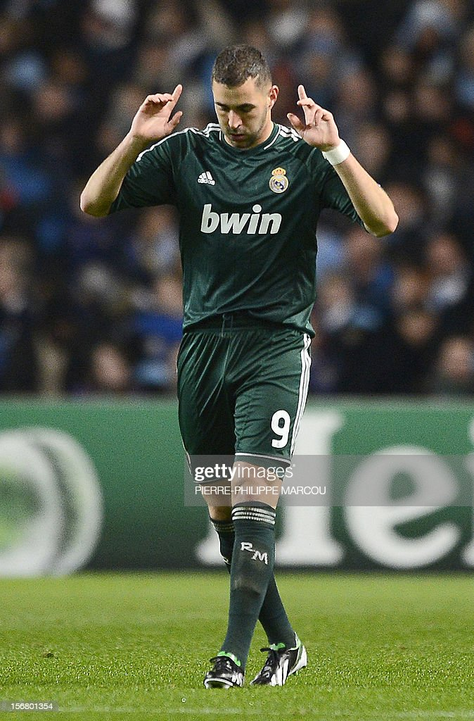 Real Madrid's French forward Karim Benzema celebrates after scoring during the UEFA Champions League group D football match between Manchester City and Real Madrid at The Etihad Stadium, in Manchester, north-west England on November 21, 2012.