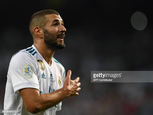 Real Madrid's French forward Karim Benzema celebrates after scoring their second goal during the second leg of the Spanish Supercup football match...