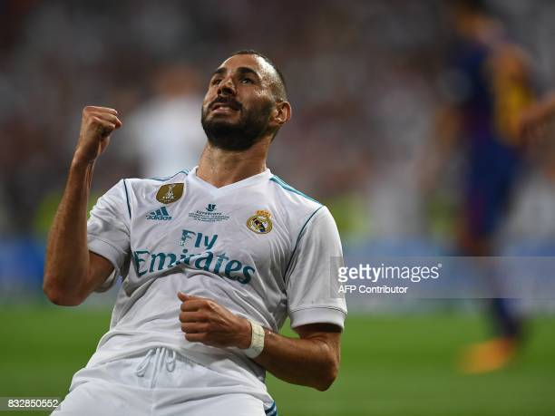 TOPSHOT Real Madrid's French forward Karim Benzema celebrates after scoring their second goal during the second leg of the Spanish Supercup football...