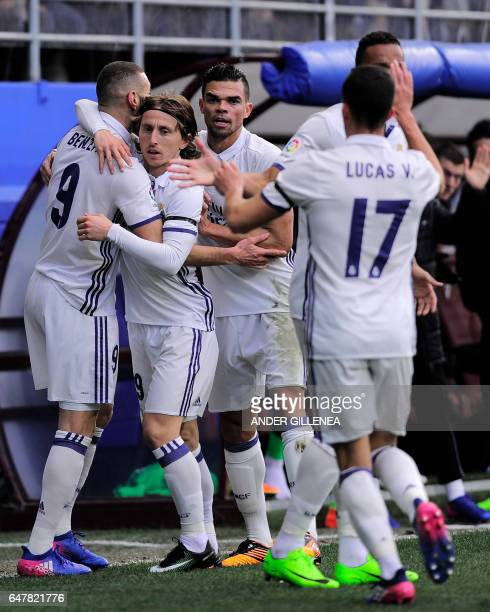 Real Madrid's French forward Karim Benzema celebrates with Real Madrid's Croatian midfielder Luka Modric and Real Madrid's Portuguese defender Pepe...