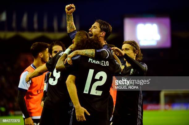 TOPSHOT Real Madrid's French forward Karim Benzema celebrates with Real Madrid's defender Sergio Ramos after scoring their third goal during the...