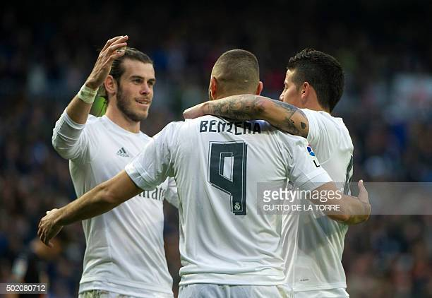 Real Madrid's French forward Karim Benzema celebrates with teammate Real Madrid's Colombian midfielder James Rodriguez and Real Madrid's Welsh...