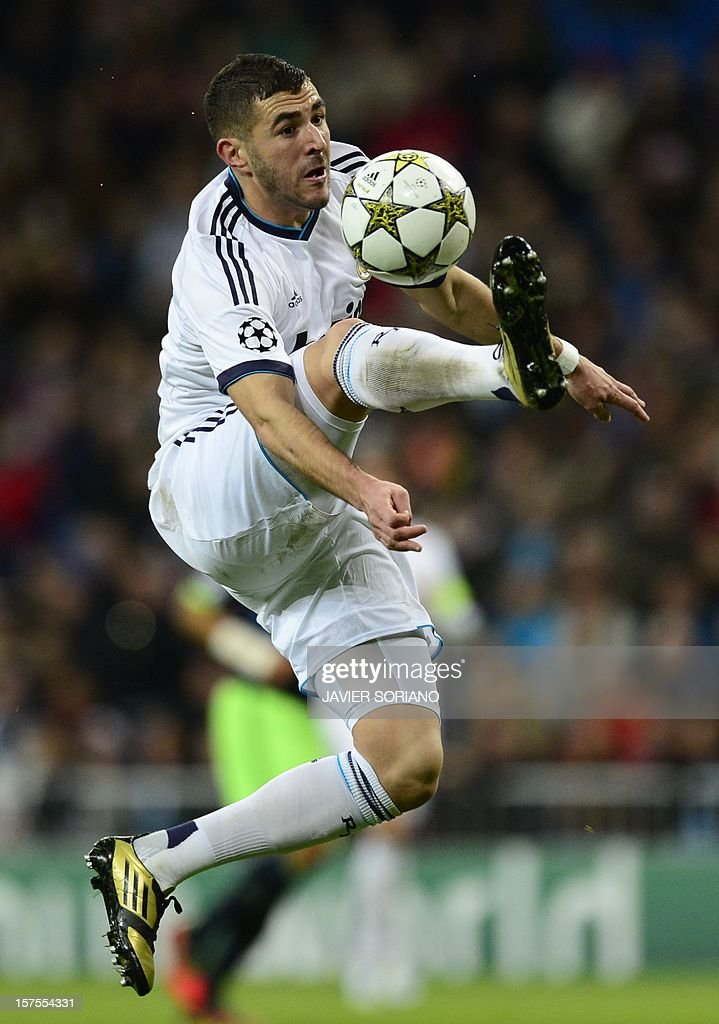 Real Madrid's French forward Karim Benzema controls the ball during the UEFA Champions League Group D football match Real Madrid vs Ajax Amsterdam at the Santiago Bernabeu stadium in Madrid on December 4, 2012. AFP PHOTO / JAVIER SORIANO