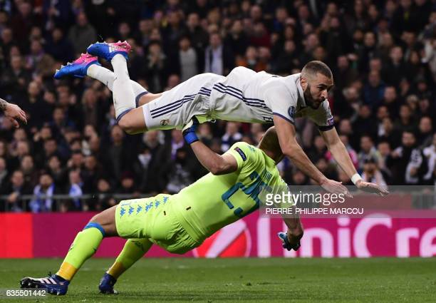 TOPSHOT Real Madrid's French forward Karim Benzema dives over Napoli's goalkeeper from Spain Pepe Reina during the UEFA Champions League round of 16...