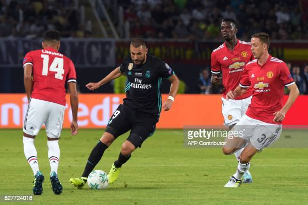 Real Madrid's French forward Karim Benzema drives the ball next to Manchester United's Serbian midfielder Nemanja Matic during the UEFA Super Cup...