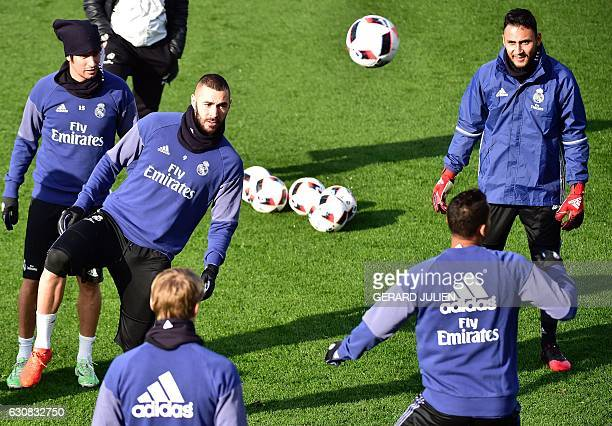Real Madrid's French forward Karim Benzema Portuguese defender Fabio Coentrao and Costa Rican goalkeeper Keylor Navas take part in a training session...