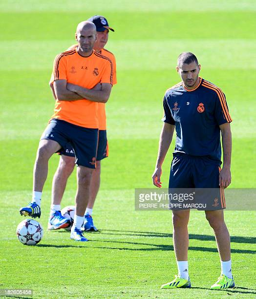 Real Madrid's French forward Karim Benzema Real Madrid's assistant manager Zinedine Zidane and Real Madrid's Italian coach Carlo Ancelotti take part...