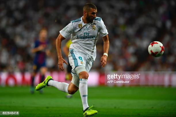 Real Madrid's French forward Karim Benzema runs with the ball during the second leg of the Spanish Supercup football match Real Madrid vs FC...