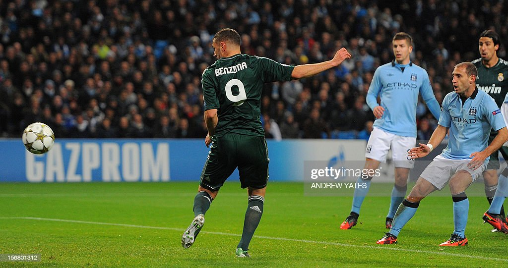 Real Madrid's French forward Karim Benzema (L) scores the opening goal during the UEFA Champions League football match between Manchester City and Real Madrid at The Etihad Stadium, in Manchester, north-west England on November 21, 2012.