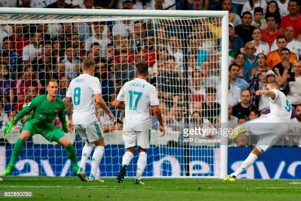 Real Madrid's French forward Karim Benzema scores their second goal during the second leg of the Spanish Supercup football match Real Madrid vs FC...