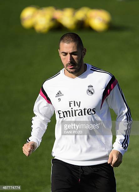 Real Madrid's French forward Karim Benzema takes part in a training session on the eve of the Spanish 'clasico' football match Real Madrid vs...