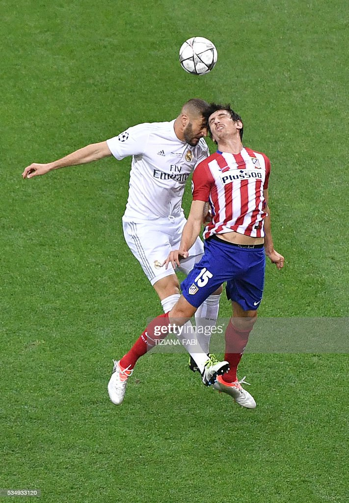Real Madrid's French forward Karim Benzema (L) vies for the ball against Atletico Madrid's Montenegrin defender Stefan Savic during the UEFA Champions League final football match between Real Madrid and Atletico Madrid at San Siro Stadium in Milan, on May 28, 2016. / AFP / TIZIANA