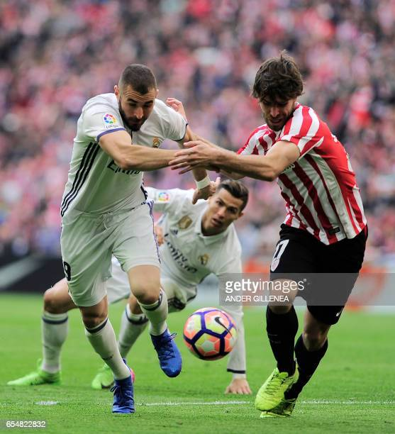 Real Madrid's French forward Karim Benzema vies with Athletic Bilbao's defender Yeray Alvarez during the Spanish league football match Athletic Club...