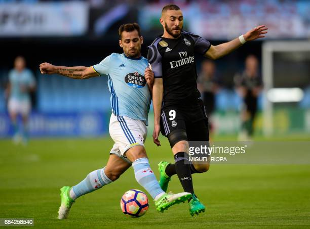 Real Madrid's French forward Karim Benzema vies with Celta Vigo's defender Jonny Castro during the Spanish league football match RC Celta de Vigo vs...