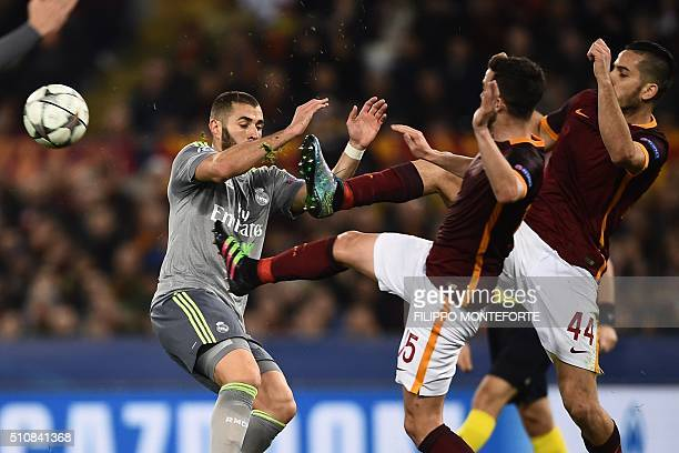 Real Madrid's French forward Karim Benzema vies with Roma's midfielder from BosniaHerzegovina Miralem Pjanic and Roma's defender from Greece Konstas...
