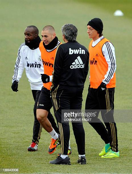 Real Madrid's French midfielder Lassana Diarra Real Madrid's French forward Karim Benzema Real Madrid's Portuguese coach Jose Mourinho and Real...