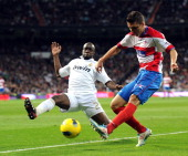 Real Madrid's French midfielder Lassana Diarra vies for the ball with Granada's Brazilian defender Guilherme Siqueira during the Spanish league...
