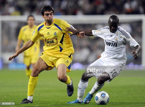 Real Madrid's French midfielder Lassana Diarra vies with Alcorcon's Ernesto during a Spanish KIng Cup football match at Santiago Bernabeu stadium on...