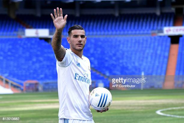 Real Madrid's French new player Theo Hernandez greets supporters during his presentation at the Santiago Bernabeu stadium in Madrid on July 10 2017 /...