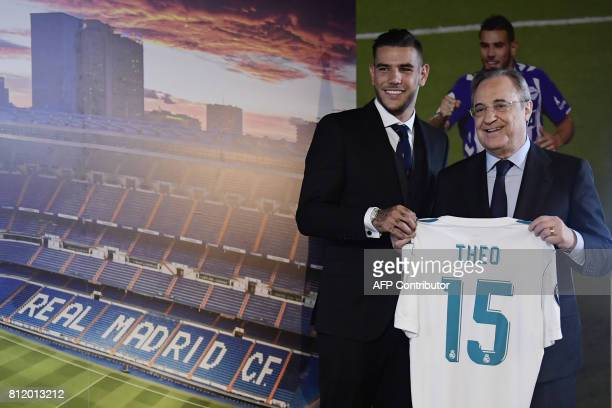 Real Madrid's French new player Theo Hernandez poses with his new shirt next to Real Madrid President Florentino Perez during his presentation at the...