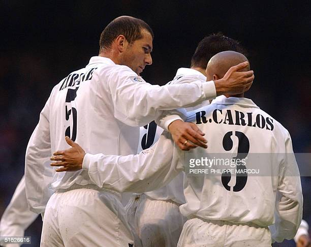 Real Madrid's French player Zidane congratulates Brazilian player Roberto Carlos who scored the first goal during their first division league match...
