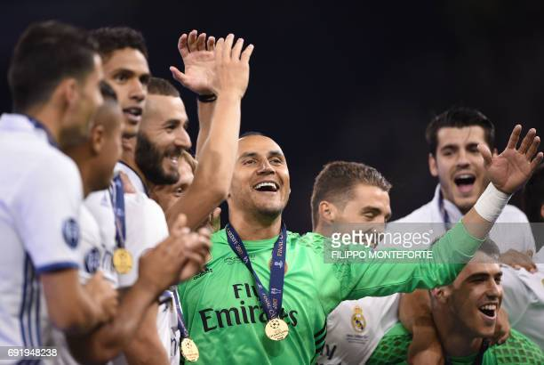 Real Madrid's French striker Karim Benzema Real Madrid's Costa Rican goalkeeper Keylor Navas and Real Madrid's Spanish goalkeeper Ruben Yanez...