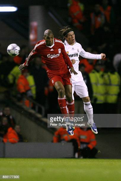 Real Madrid's Garcia Sergio Ramos and Liverpool's Ryan Babel battle for a ball in the air