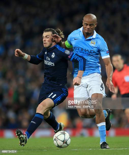 Real Madrid's Gareth Bale and Manchester City's Vincent Kompany battle for the ball