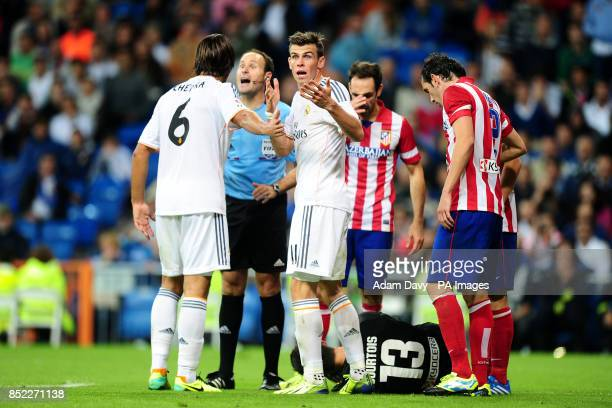 Real Madrid's Gareth Bale argues his point after fouling the Atletico Madrid goalkeeper Thibaut Courtois