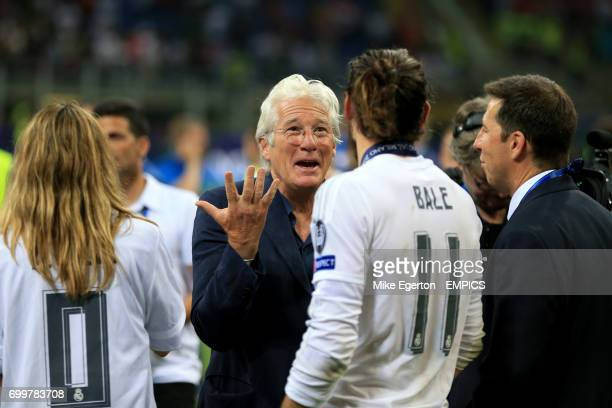 Real Madrid's Gareth Bale celebrates with Richard Gere on the pitch after his side's victory over Atletico Madrid