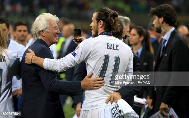 Real Madrid's Gareth Bale celebrates with Richard Gere