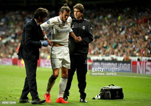 Real madrid's Gareth Bale is treated for an injury