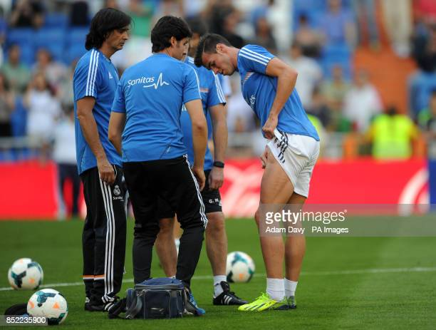 Real Madrid's Gareth Bale looks at his thigh during the warm up before the La Liga match at Santiago Bernabeu Madrid Spain