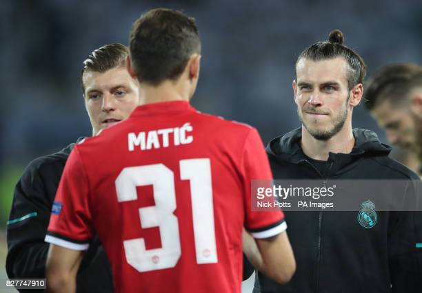 Real Madrid's Gareth Bale shakes hands with Manchester United's Nemanja Matic before the UEFA Super Cup match at the Philip II Arena Skopje Macedonia
