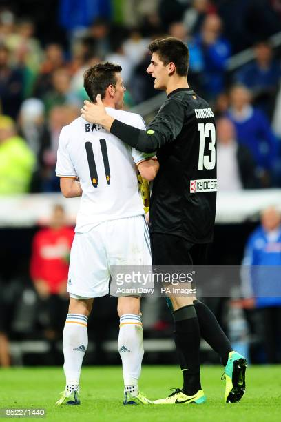 Real Madrid's Gareth Bale with Atletico Madrid goalkeeper Thibaut Courtois at the final whistle