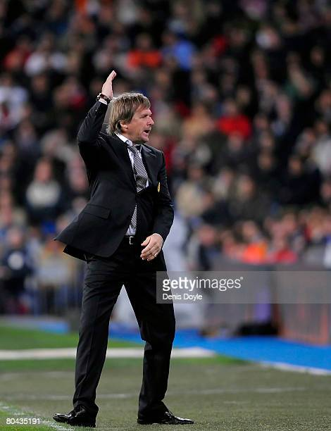 Real Madrid's German manager Bernd Schuster reacts during the La Liga match between Real Madrid and Sevilla at the Santiago Bernabeu stadium on March...