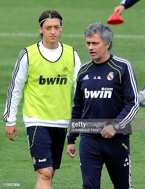 Real Madrid's German midfielder Mesut Ozil and Real Madrid's Portuguese coach Jose Mourinho take part in a training session in Madrid on April19 on...