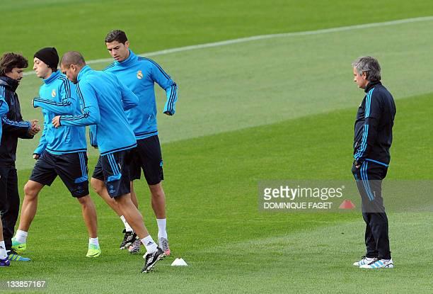 Real Madrid's German midfielder Mesut Ozil Real Madrid's Portuguese defender Pepe Real Madrid's Portuguese forward Cristiano Ronaldo and Real...