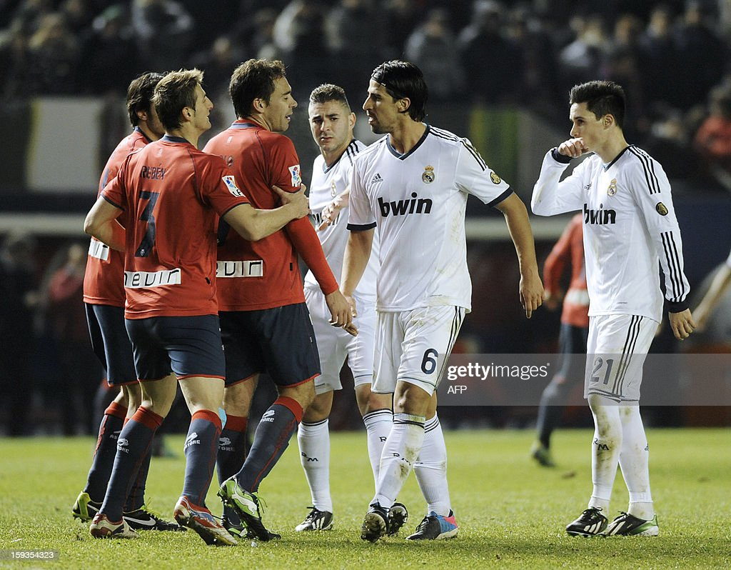 Real Madrid's German midfielder Sami Khedira (2nd R) reacts after two of his teammates received a yellow card during the Spanish league football match CA Osasuna vs Real Madrid CF at the Reyno de Navarra stadium in Pamplona on January 12, 2013. The match ended in a 0-0 draw.