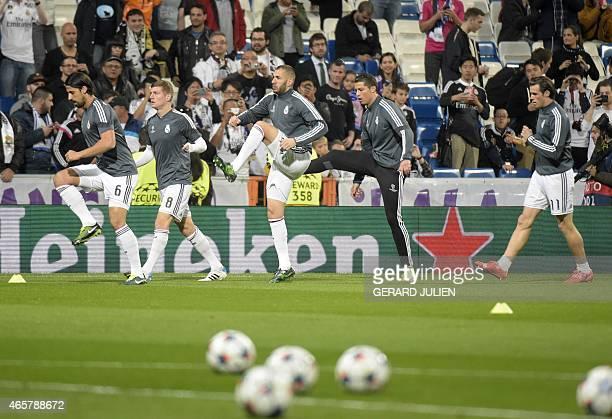 Real Madrid's German midfielder Sami Khedira Real Madrid's German midfielder Toni Kroos Real Madrid's French forward Karim Benzema Real Madrid's...