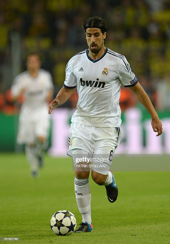 Real Madrid's German midfielder Sami Khedira runs with the ball during the UEFA Champions League semi final first leg football match between Borussia Dortmund and Real Madrid on April 24, 2013 in Dortmund, western Germany. Dortmund won the match 4-1. AFP PHOTO / PATRIK STOLLARZ