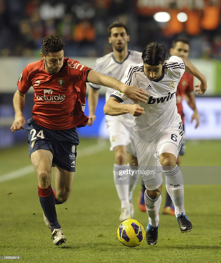 Real Madrid's German midfielder Sami Khedira (R) vies with Osasuna's defender Damia Abella (L) during the Spanish league football match CA Osasuna vs Real Madrid CF at the Reyno de Navarra stadium in Pamplona on January 12, 2013.