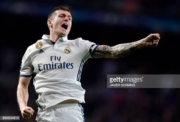 Real Madrid's German midfielder Toni Kroos celebrates a goal during the UEFA Champions League round of 16 first leg football match Real Madrid CF vs...