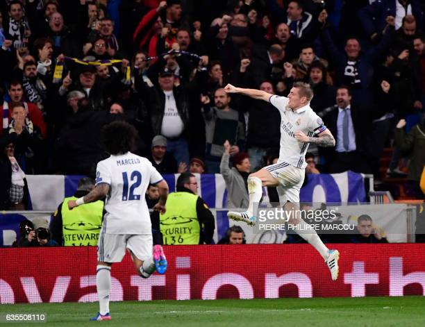 TOPSHOT Real Madrid's German midfielder Toni Kroos celebrates a goal during the UEFA Champions League round of 16 first leg football match Real...